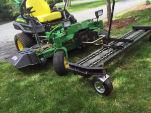 zero-turn mower with thatching attachment