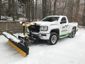 white truck snow plowing