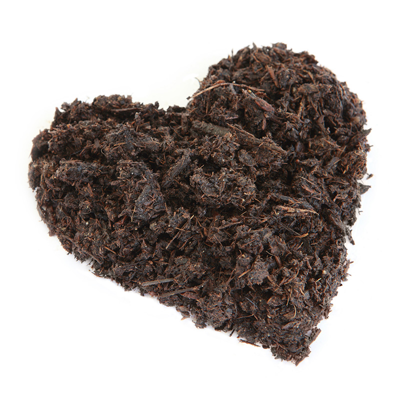 brown mulch pile in shape of heart on white background